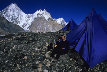 Relaxing outside my tent on the Baltoro glacier, Pakistan. (Photo by Mario Pinoli)
