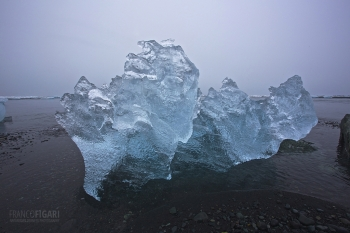 ISL0315_0140_Ice block on the seashore (Jökulsárlón, Iceland)