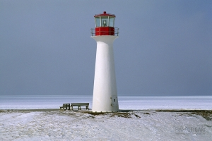 CAN0207_0142_Lighthouse on the sea ice (Iles de la Madeleine, Québec, Canada)